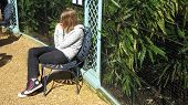 Girl/Teenager Sitting Alone Enjoying The Sun