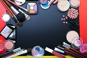 Постер, плакат: Cosmetics make up on black background Top view mock up