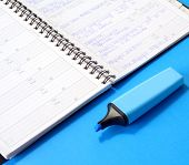Notepad And Blue Marker
