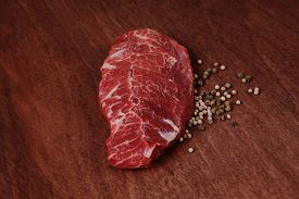 pic of peppercorns  - fresh raw beef meat steak with white and green peppercorn spice on walnut table - JPG