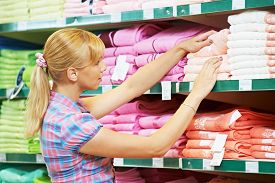 picture of apparel  - woman choosing bath towels textile in apparel clothes shop supermarket - JPG