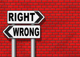 stock photo of moral  - right wrong answer decision morally good or bad moral dilemma difficult choice or quiz and exam results choose your way road sign arrow  - JPG