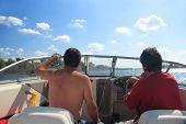 Men In A Motor Boat