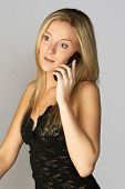 Young Blonde Woman Talking On Cell Phone