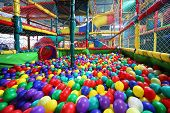 stock photo of chute  - Much varicoloured bright balls are poured in sector for slide from chute - JPG