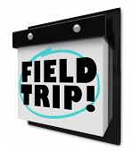 A wall calendar with tear-away pages, and words reading Field Trip, representing a school outing or