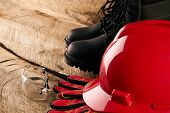 Red Safety Helmet Or Hardhat With Safety Glasses And Other Standard Safety Workwear poster