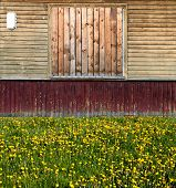 Old Russian Style Exterior With Old Painted Wooden Planks Building Number Boarded Up Window Grass An