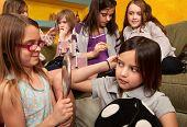 Little Girls Fixing Their Hair