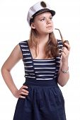 Girl In A Sailor Cap Smoking A Pipe