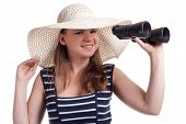 A Girl In A Big Straw Hat Looking Through Binoculars