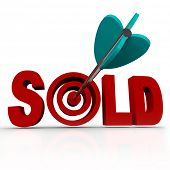 The word Sold with an arrow striking a bullseye target, representing a transaction that has been completed between a buyer and a seller, successfully transferring ownership of an object