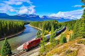 Long Freight Train Moving Along Bow River In Canadian Rockies ,banff National Park,canadian Rockies, poster