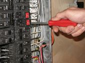 Tightening a connection on an electrical panel