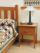 Bedroom with Mission-style bedroom furniture and handmade patchwork quilt