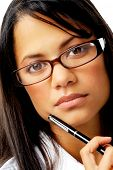 Expressionless woman holding a pen to her face with nerdy spectacles