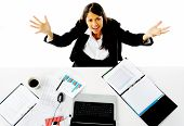 image of overwhelming  - businesswoman is stressed and asks for help with a gesture of arms out towards the camera - JPG