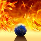 conceptual climate change image of world over fire flames. poster