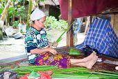 LOMBOK, INDONESIA - FEBRUARY 14 - Sasak woman make basket from leaf of palm  tree on February 14,201