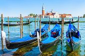 Gondolas In Venice, Italy. Beautiful View Of Venice From San Marco Embankment. Gondola Is Romantic T poster