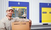 smiling delivery man and warehouse background
