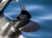 foto of outboard engine  - outboard engine propeller on the blue water - JPG