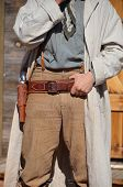 stock photo of olden days  - wild west cowboy with holster and revolver - JPG