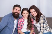 Friendly Family Sit Couch Posing For Photo Family Album. Mom Dad And Daughter Relaxing On Couch. Clo poster