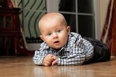 6 Months Male Child Sitting On Floor