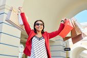 Jolly Positive Young Black Woman In Sunglasses Excited About Shopping Sales Raising Hands Full Of Co poster