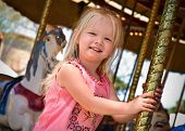 Child On Carousel