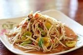 stock photo of papaya  - thai papaya salad hot and spicy mixed from variety of vegetable - JPG