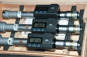 picture of micrometer  - Wooden box with three inside micrometer with digital display - JPG
