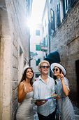 Happy Group Of Tourists Traveling And Sightseeing Together poster