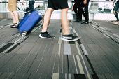 Blurred Of Traveling Traveler Luggage Walking At Airport Terminal For Checkin With Light Flare. Trav poster