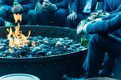 Filtered Image Businesspeople Hangout Near Patio Fire Pit At Wintertime In Chicago, America poster