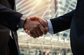 Partnership. Close Up Business Man In Modern Suit Hands Shaking After Finishing Up A Business Meetin poster