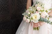 Wedding Bouquet In Female Hands. Beautiful Bouquet In Hand. Bouquet Of Peonies. Bouquet With Roses. poster