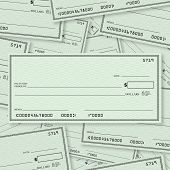 A pile of blank checks with a single check on top in straight layout with open spacing for you to place your own words