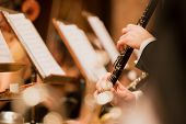 clarinet during a classical concert music, close-up. poster