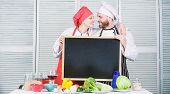 Enjoy The Fun Unfolding In The Kitchen. Master Cook And Prep Cook Hugging In Cooking School. Couple  poster