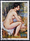 naked woman in a landscape by Renoir