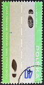 a stamp printed in Poland shows scheme for foot-passenger explaining rules of the road