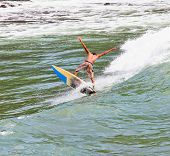 BALI, INDONESIA - JANUARY 13: Unidentified young surfer on the board on January 13, 2012. Dreamland