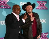 LOS ANGELES - DEC 20:  LA Reid, Tate Stevens - Winner of 2012 X Factor at the 'X Factor' Season Fina