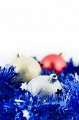 Christmas Colored Balls In Blue Tinsel Vertical Orientation Soft Focus poster