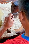 JAVA, INDONESIA - JANUARY 4: Javanese Wayang kulit worker made famous shadow puppet  on January 4 20