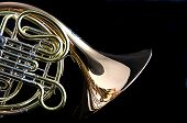 Brass Or Gold French Horn Isolated On Black