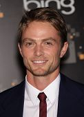 LOS ANGELES - AUG 10:  Wilson Bethel arriving to CW Premiere Party  on August 10, 2011 in Burbank, C