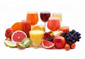 stock photo of fruit-juice  - Glasses of fruit and vegetable juice with fruits on a white background - JPG